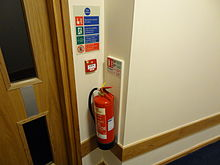 220px-Fire_extinguisher_with_ID_sign,_call_point_and_fire_action_sign
